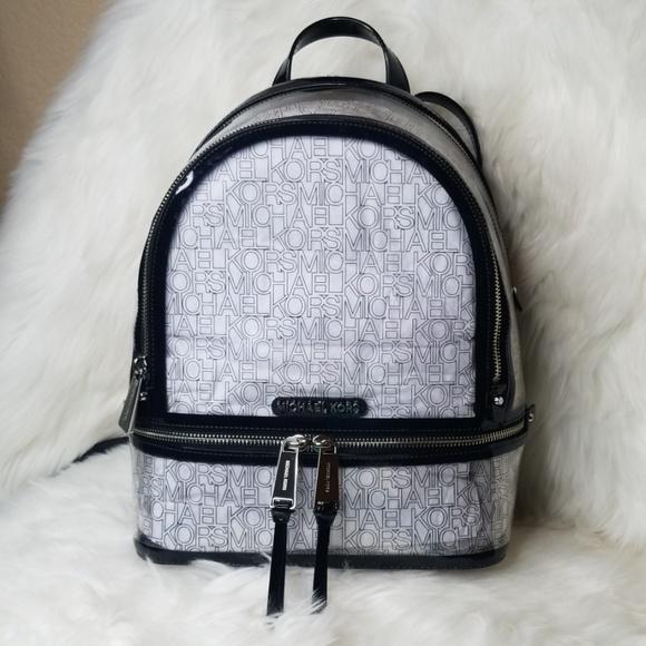 Michael Kors Handbags - NWT MICHAEL KORS MK RHEA ZIP BACKPACK CLEAR BLACK